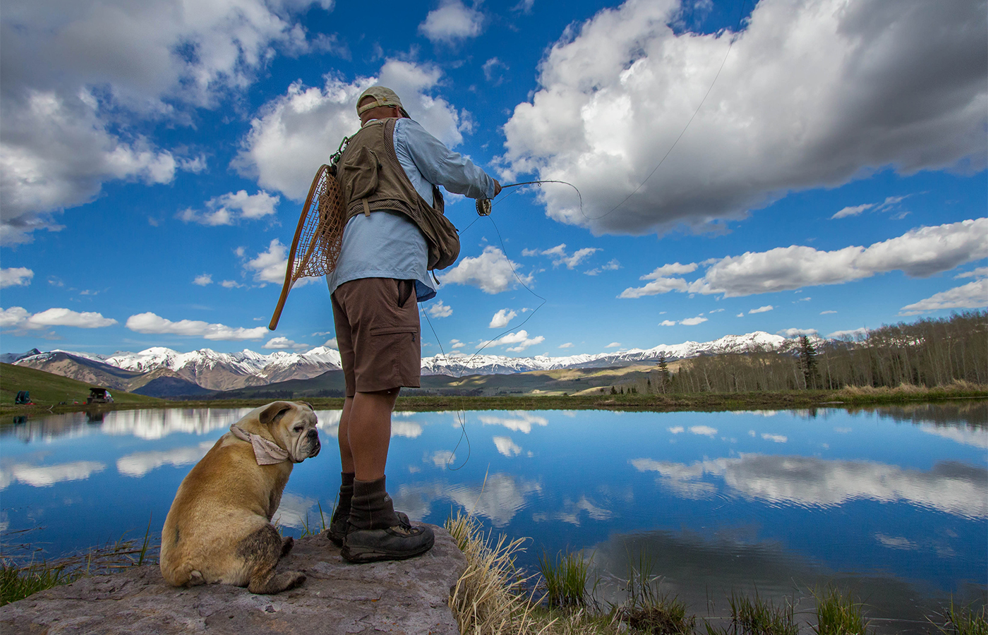 fly fisher and dog